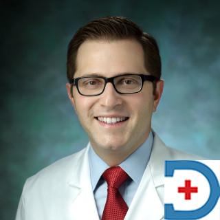Dr Justin M. Caplan